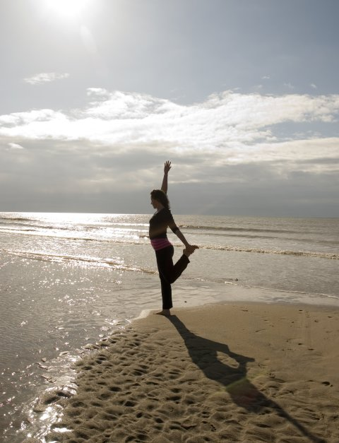 Lisa Powell yoga posture, Camber Sands beach